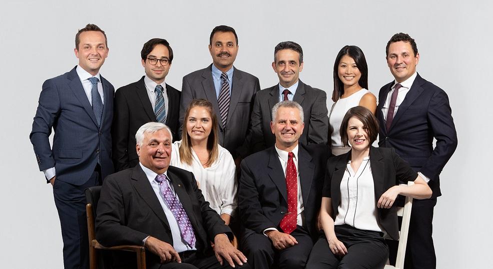 8 men and 3 women smiling